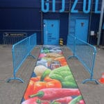 A ground painting as a creative red carpet