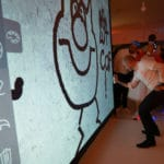Spraying digital graffiti during an event in France.