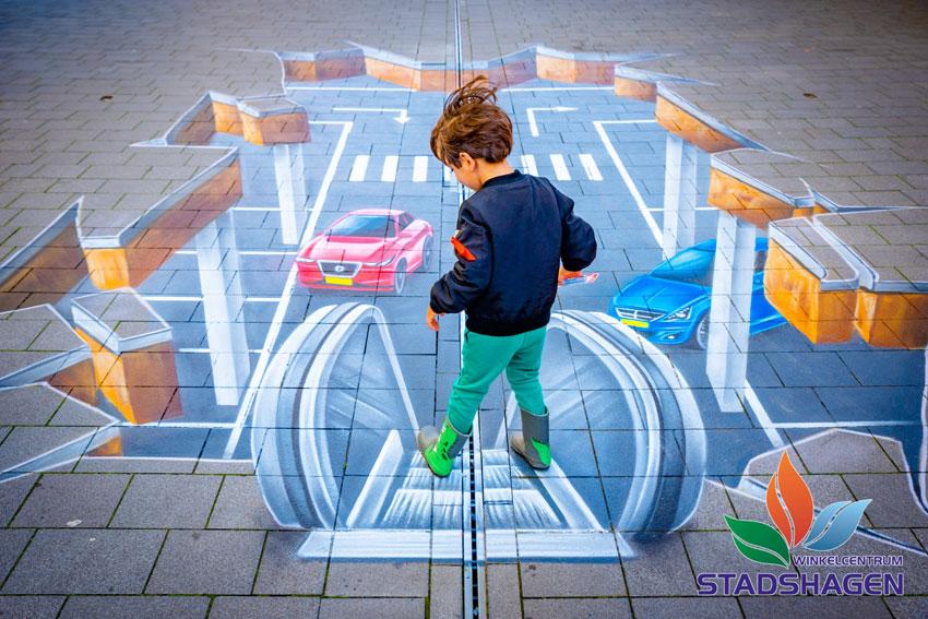 Ein 3D-Straßengemälde als Einkaufszentrumwerbung